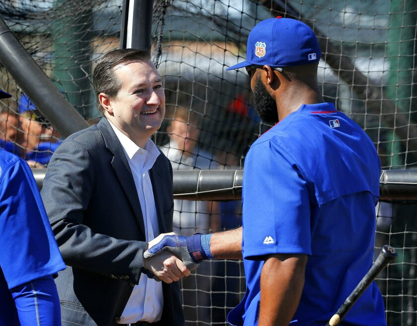 Chicago Cubs owner Tom Ricketts, left, greets Jason Heyward during spring training baseball practice, Wednesday, Feb. 24, 2016, in Mesa, Ariz. (AP Photo/Matt York)