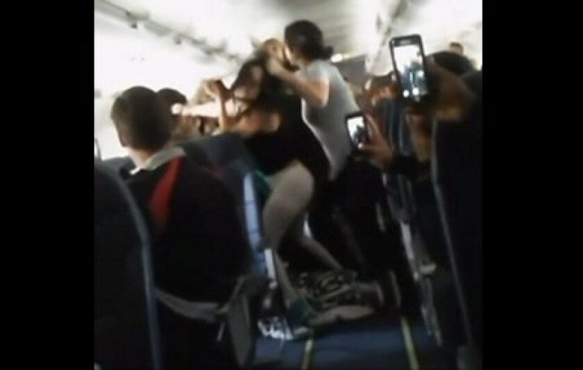 In this screenshot from Instagram video, women are seen fighting while onboard a Spirit Airlines flight that was headed to Los Angeles.