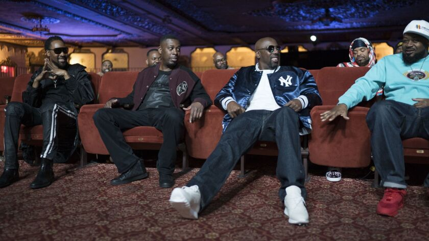 """Members of the Wu-Tang Clan, front row from left, RZA, GZA, Inspectah Deck and Ghostface Killah, reminisce in Showtime's docuseries """"Wu-Tang Clan: Of Mics and Men."""""""