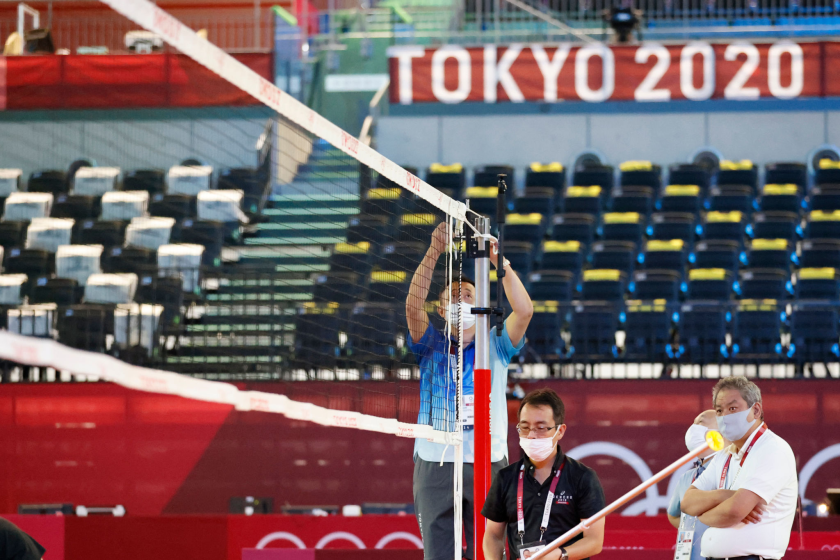 TOKYO, JAPAN - JULY 19: Officials prepare a volleyball net at the Ariake Arena.
