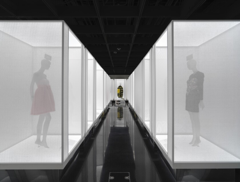 """This image released by The Metropolitan Museum of Art shows fashion displays, titled from left, Wonder, Warmth and Joy, part of the """"In America: A Lexicon of Fashion"""" exhibit at The Metropolitan Museum of Art in New York. (The Metropolitan Museum of Art via AP)"""