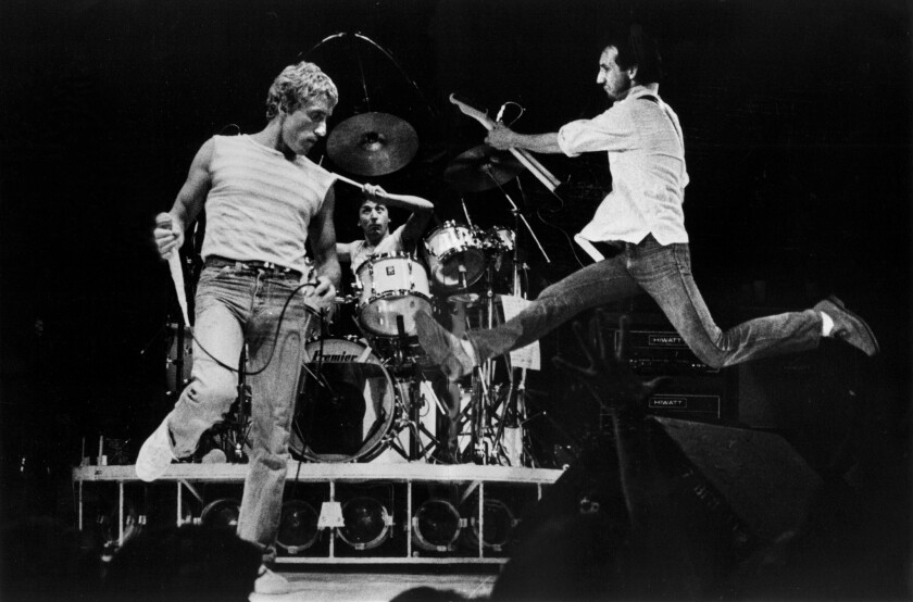 June 24, 1980: Pete Townshend leaping with Roger Daltrey and drummer Kenney Jones of THE WHO, in con