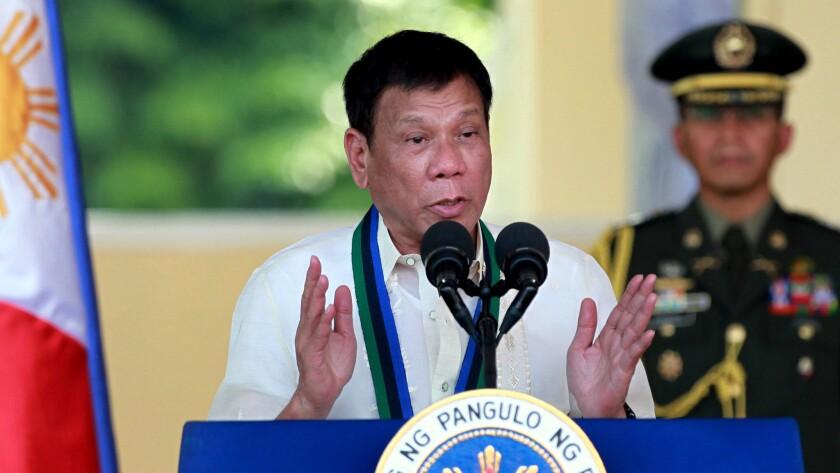 Philippine President Rodrigo Duterte speaks at a military ceremony in suburban Quezon city, northeast of Manila.