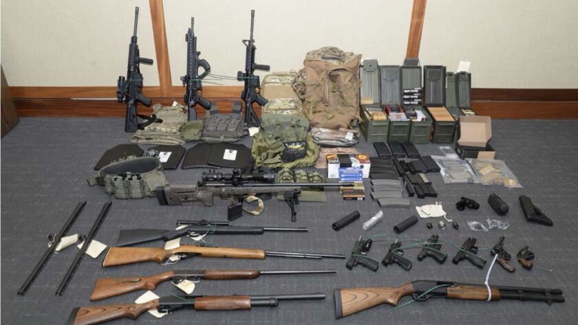 Federal authorities display weapons seized from the Silver Spring, Md., home of Coast Guard officer Christopher Paul Hasson.