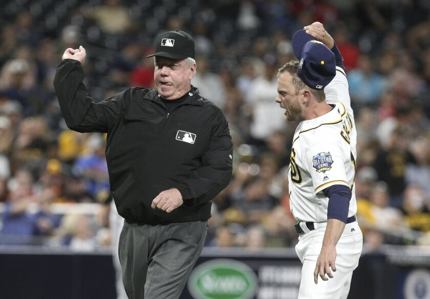 The Padres' manager Andy Green throws his cap down as third base umpire Brian Gorman throws Green out of the game after Green argued a balk call on Padres' pitcher Colin Rea giving the Pirates a run in the third inning at Petco Park in San Diego on Tuesday.