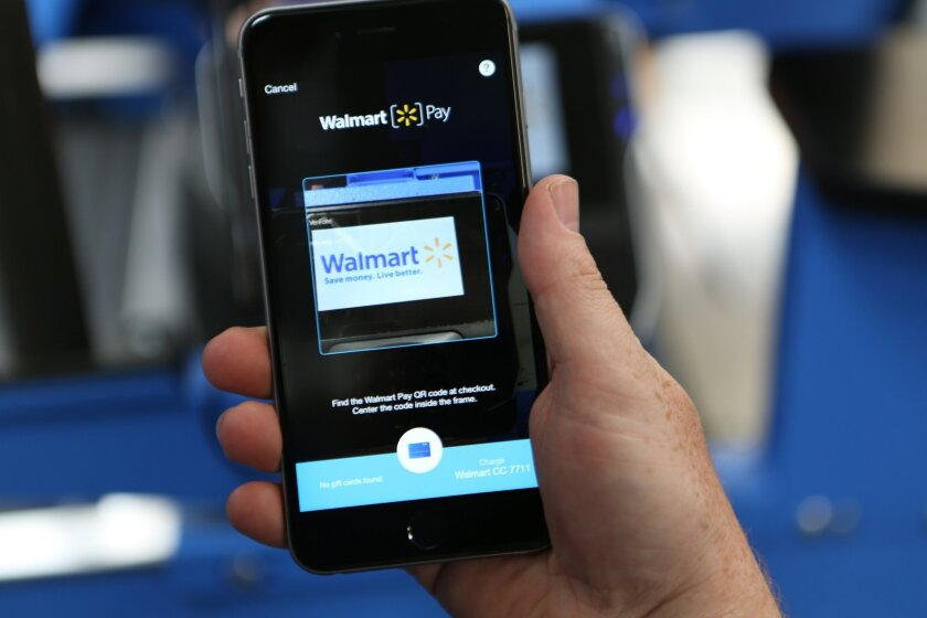 In this photo provided by Wal-Mart, the company's Walmart Pay is demonstrated. Wal-Mart will now let you pay with your phone at all 4,600 stores nationwide. With Walmart Pay, the cashier scans a QR code on the phone screen to complete the payment. The effort is part of Wal-Mart's overall strategy t