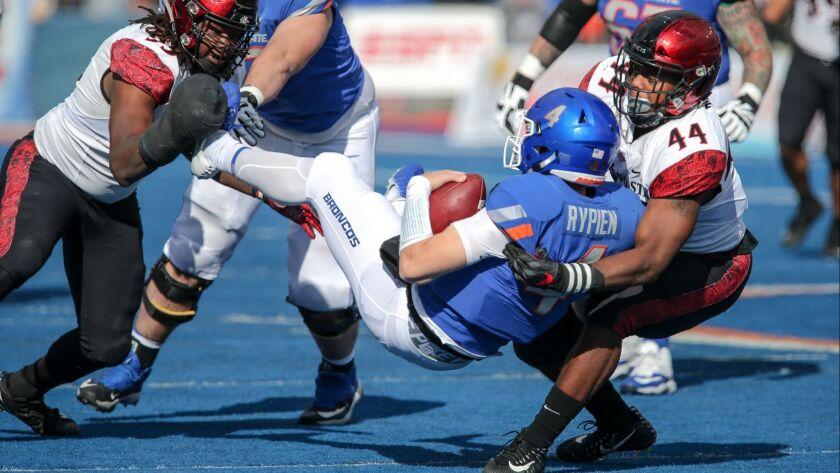Aztecs linebacker Kyahva Tezino (44) throws Boise State quarterback Brett Rypien to the ground during second half action on October 6, 2018 at Albertsons Stadium in Boise, Idaho.
