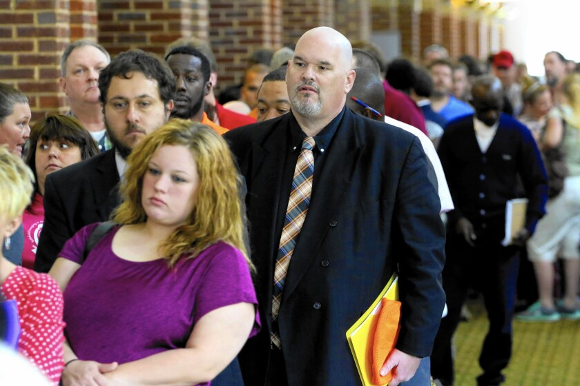 Job gains in May were mostly in the service sector, which accounted for 95% of the new jobs, according to ADP. Above, job seekers at a career fair in Georgia.