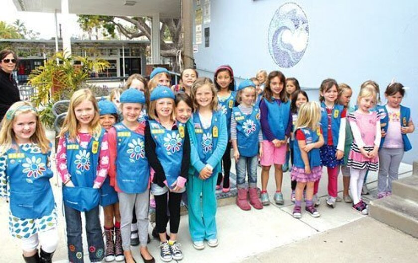 La Jolla Girl Scout Daisy Troops 3869 and 4186 watch the raising of the flags they purchased for Bird Rock Elementary School. Courtesy Photos