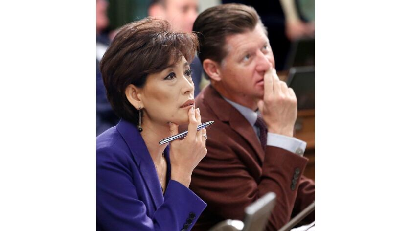 A 2015 file photo of Republican Assembly members Young Kim, of Fullerton, and Brian Jones, of Santee, at a budget hearing at the state Capitol. Kim's campaign says someone stole 30 tablets and a laptop computer from her Orange County campaign office.