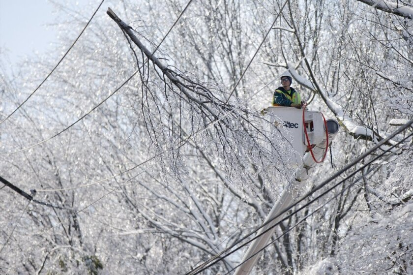 A utility worker tries to restore power in Downingtown, Pa. As of Sunday, at least 50,000 Pennsylvania power customers remained without electricity after a Wednesday morning storm.
