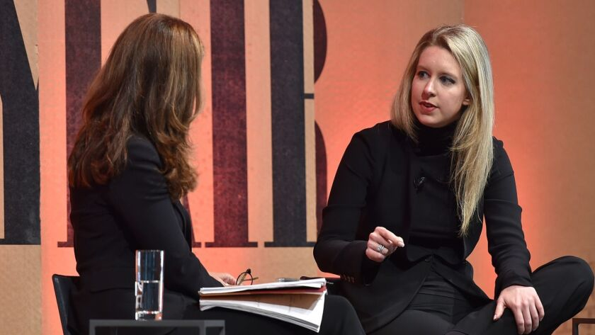 Happier times: Theranos founder Elizabeth Holmes (right) chats with Maria Shriver of NBC during a Vanity Fair magazine event in 2015.