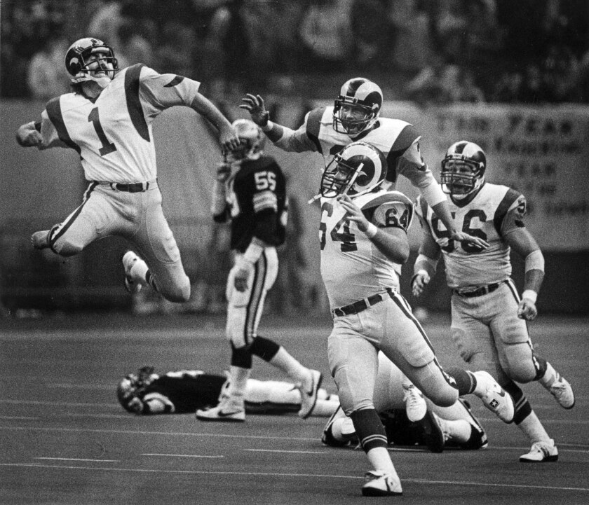 Dec. 18, 1983: The Rams' Mike Lansford, left, celebrates after kicking a game-winning field goal against the New Orleans Saints and getting Los Angeles into the NFC playoffs.