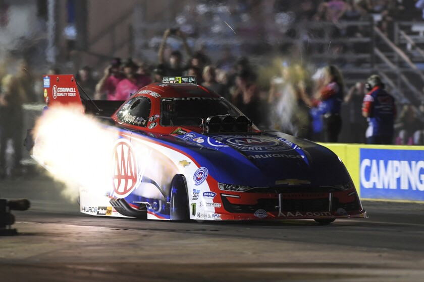 In this photo provided by the NHRA, Robert Hight takes part in Funny Car qualifying Friday, Oct. 8, 2021, at the Texas NHRA FallNationals drag races at Texas Motorplex in Ennis, Texas. (NHRA via AP)