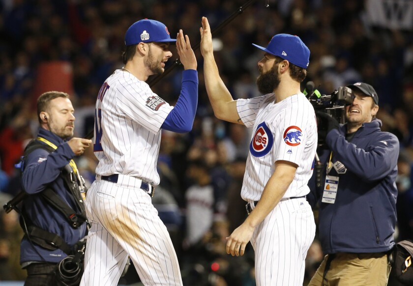 Cubs third baseman Kris Bryant, second from left, celebrates with pitcher Jake Arrieta after Game 5 of the World Series against the Cleveland Indians.
