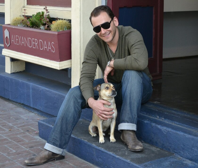 Alexander Daas outside his Gaslamp showroom with pet Czar Puptician. Courtesy photo