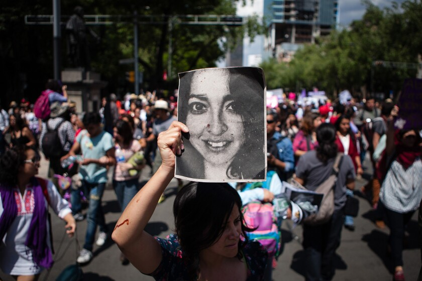 Thousands of women march April 24 in Mexico City.