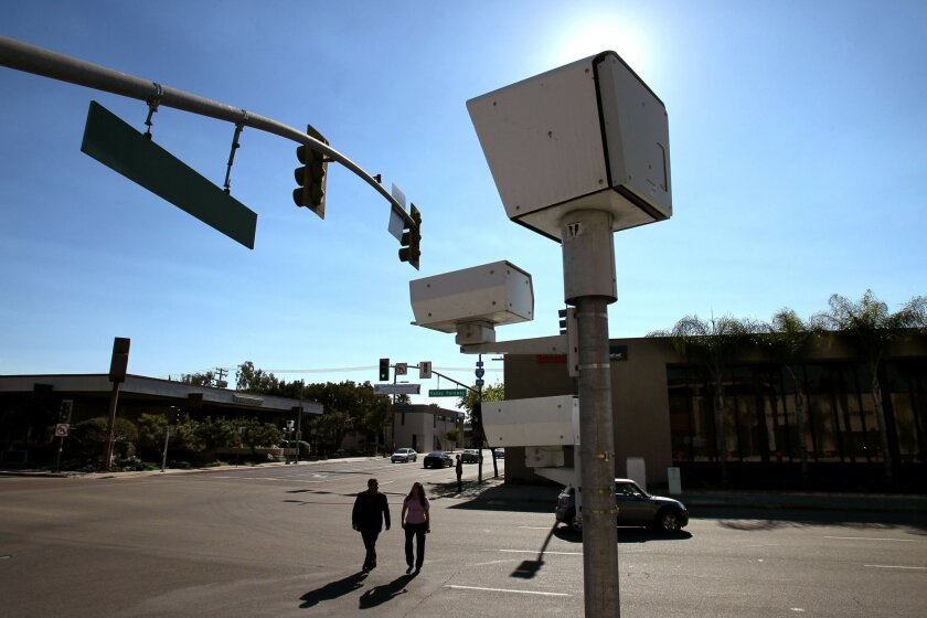 Red-light cameras, like this one in Escondido, will be turned off in Poway for a six-month trial period.