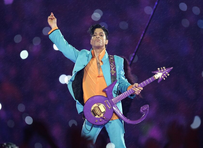 FILE - In this Feb. 4, 2007 file photo, Prince performs during the halftime show at the Super Bowl XLI football game at Dolphin Stadium in Miami. For the first full sales week following Prince's death on April 21, 2016, five of his albums were in Billboard's top 10, at Nos. 2, 3, 4, 6 and 7. Only B