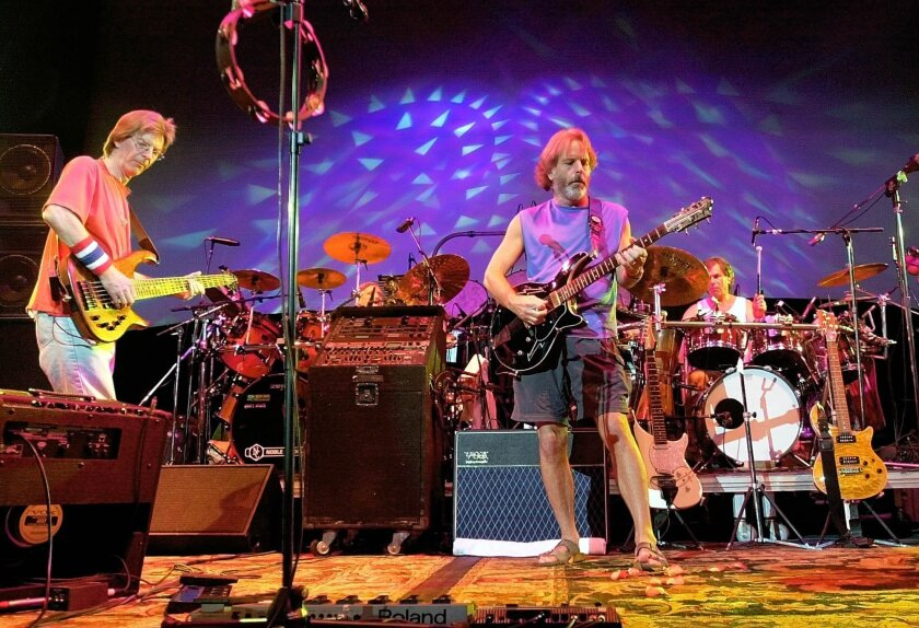 FILE - In this Aug. 3, 2002 file photo, The Grateful Dead, from left, Phil Lesh, Bill Kreutzmann, Bob Weir and Mickey Hart perform during a reunion concert in East Troy, Wis. Mickey Hart, Bill Kreutzmann and Bob Weir have joined forces with John Mayer to form the band, Dead & Company. They will per