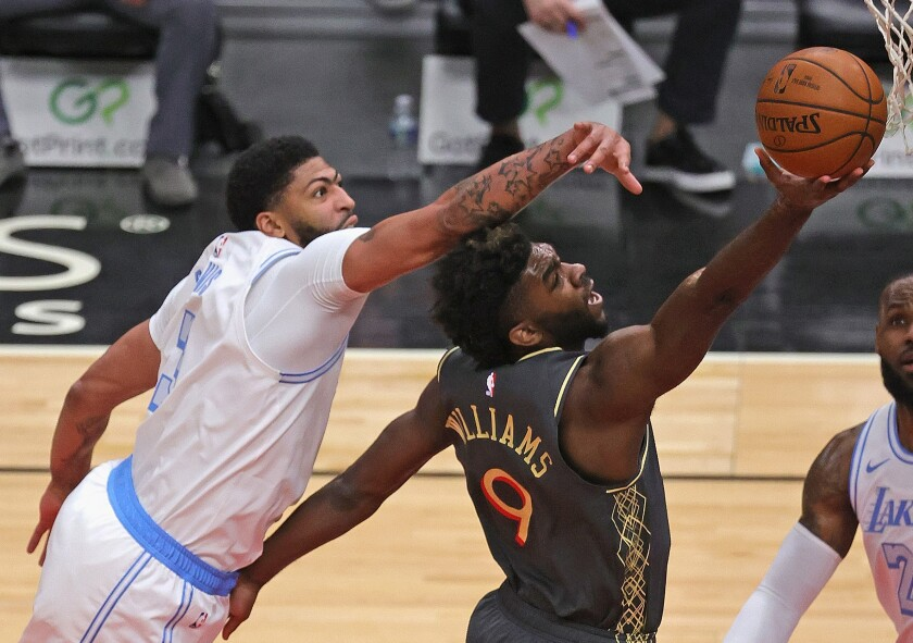 Lakers forward Anthony Davis challenges a shot by Bulls forward Patrick Williams on Jan. 23, 2021, in Chicago.