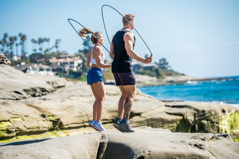 Brittany Weiss (left) and Bryce Smith get an incredible view for their workout at Windansea Beach in La Jolla.