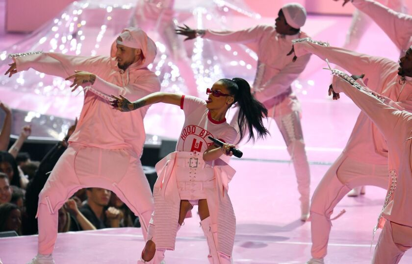 Rihanna and a stage full of dancers perform in one of her many sets during the night.