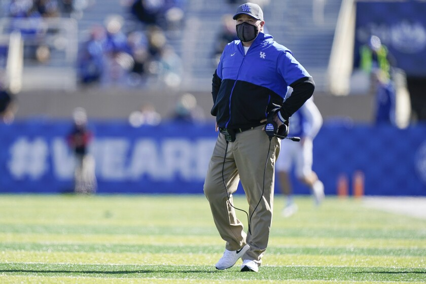 Kentucky head coach Mark Stoops walks on the field during the first half before an NCAA college football game against Georgia, Oct. 31, 2020, in Lexington, Ky. (AP Photo/Bryan Woolston)
