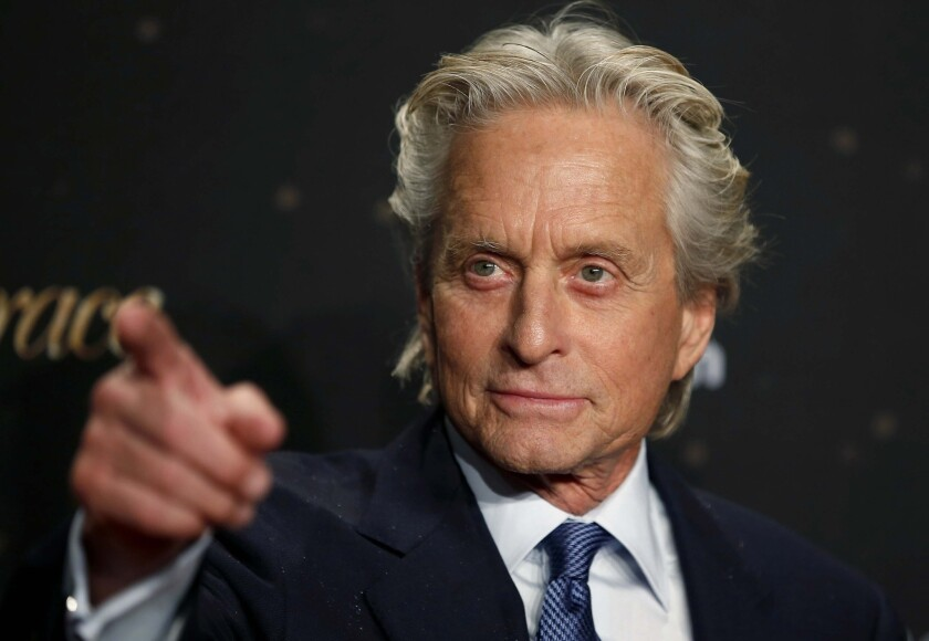 """Actor Michael Douglas arrives for the German premiere of the movie """"Behind The Candelabra"""" in Berlin. The Liberace biopic scored eight awards at the 65th Annual Creative Arts Emmys."""