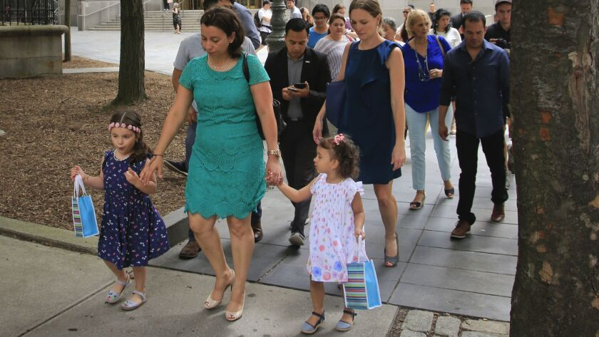 Pablo Villavicencio's wife Sandra Chica, center, leave federal court with their two daughters, after
