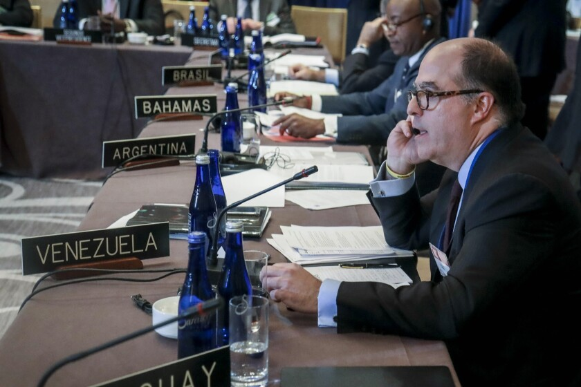 FILE - In this Sept. 23, 2019, file photo, Julio Borges, a Venezuelan opposition leader, participates in a meeting organized by the Organization of American States to discuss sanctions on Venezuela in New York. Borges, a former Venezuelan lawmaker is now exiled in Colombia. (AP Photo/Bebeto Matthews, File)