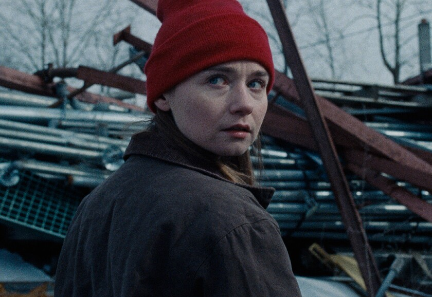 """A young woman in a knit cap looks back over her right shoulder in the movie """"Holler."""""""