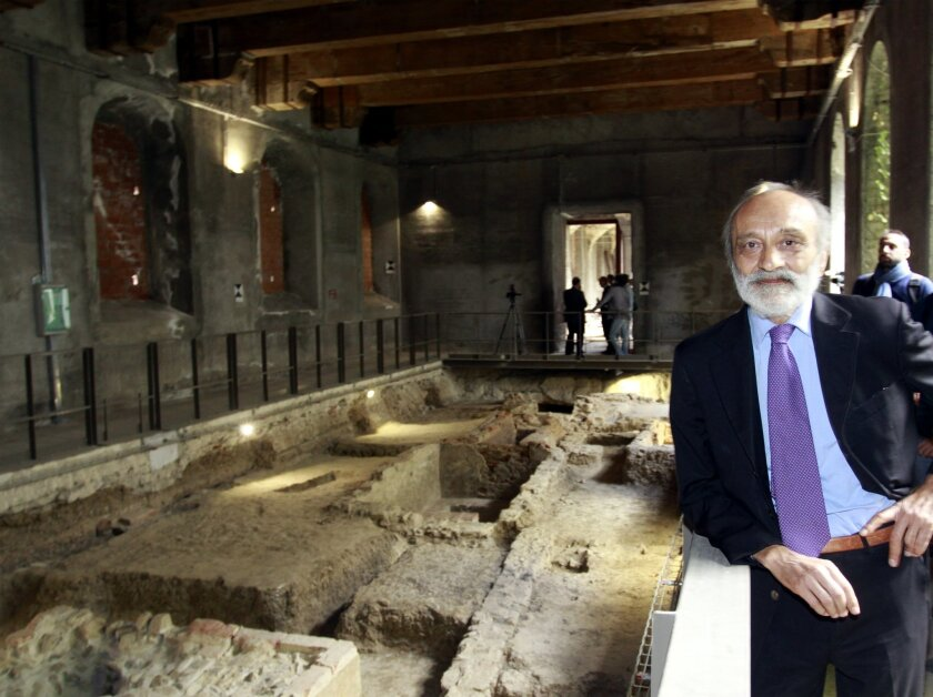 Head researcher Silvano Vinceti pose for photographers in front of excavation site inside the Sant'Orsola monastery in Florence, Italy, Thursday, Sept. 24, 2015, where archeologists found bones they hoped belonged to Lisa Gherardini, the woman some believe posed for the famous Leonardo da Vinci's Mona Lisa painting. Vinceti said during a press conference he can't say with certainty whether the bones dug up in the monastery are those of the Renaissance-era noblewoman. (AP Photo/Francesco Bellini)