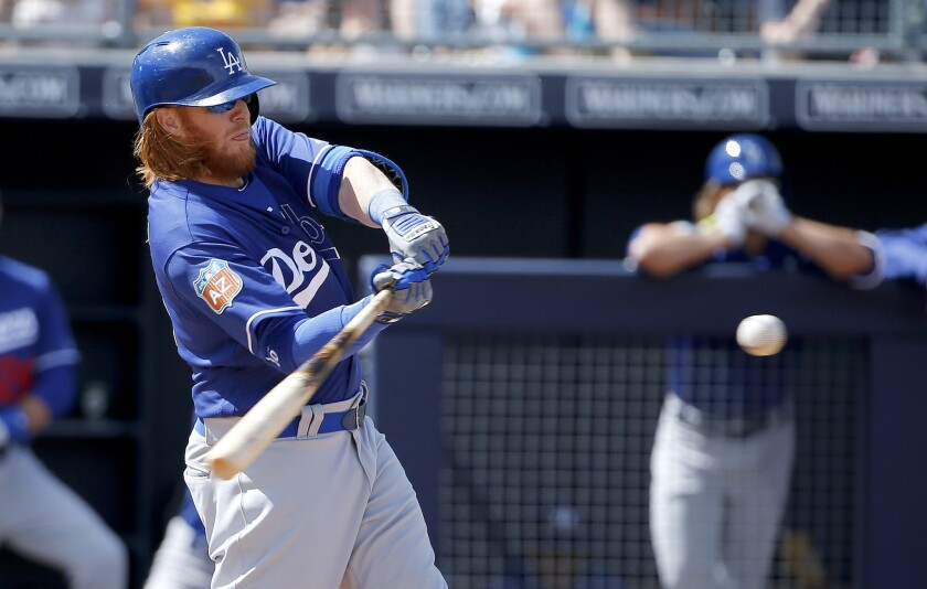 Dodgers third baseman Justin Turner hit his third home run of spring training during the fifth inning of a game against the Padres on March 29.