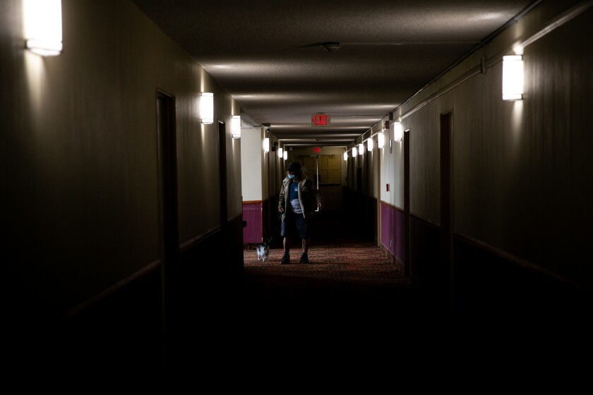 Michael Vorgang heads to his room at Marty's Valley Inn on Tuesday, April 13, 2021 in Oceanside, CA.