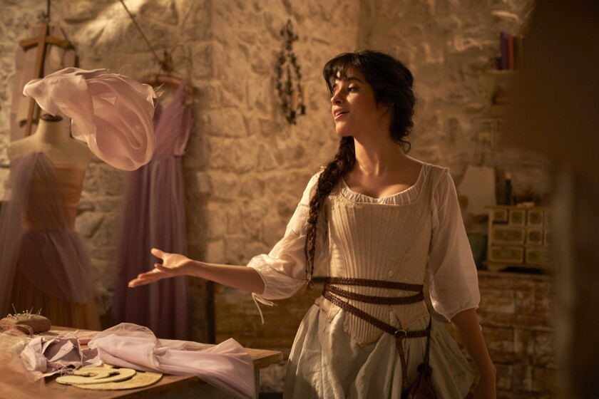 """This image released by Amazon shows Camila Cabello in a scene from """"Cinderella."""" (Kerry Brown/Amazon via AP)"""