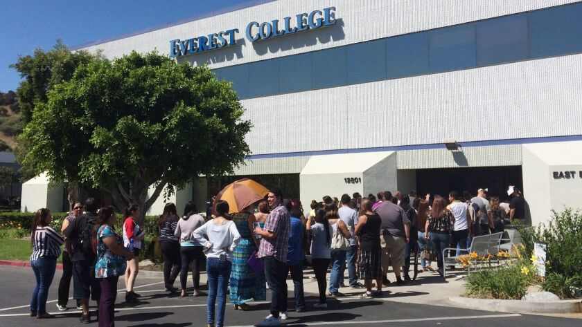 FILE - In this April 28, 2015 file photo, students wait outside Everest College in Industry, Calif.,