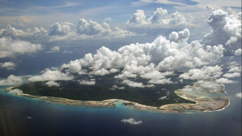 FILE -In this Nov. 14, 2005 file photo, clouds hang over the North Sentinel Island, in India's south