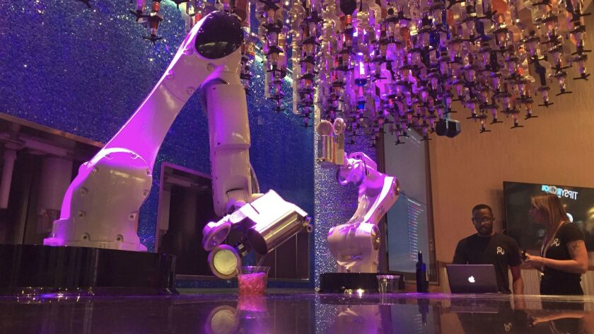 Robots serve drinks at The Tipsy Robot which opened about three weeks ago inside the Miracle Mile Sh