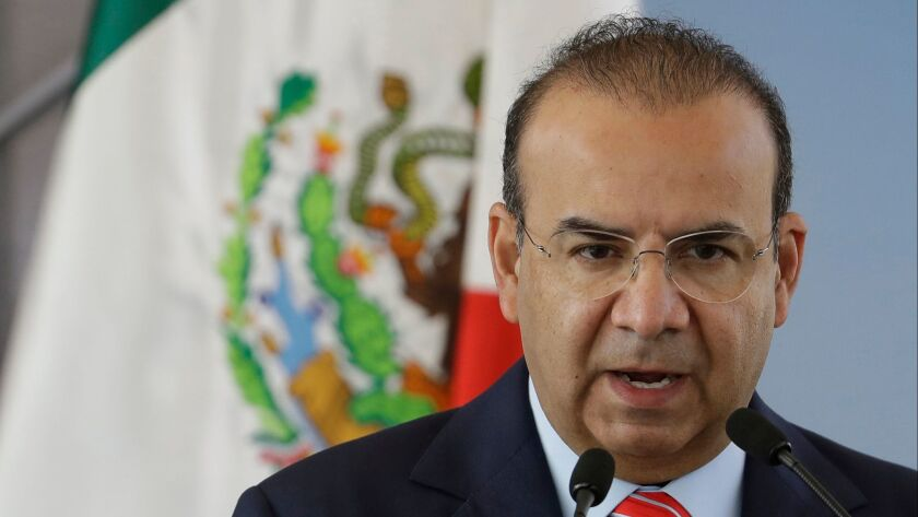 Mexico's Interior Secretary Alfonso Navarrete, shown on Tuesday, has said the federal intelligence agency sent a plainclothes agent to tail an opposition presidential candidate.