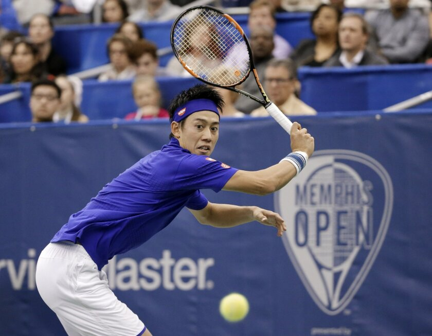 Kei Nishikori of Japan returns a shot to Taylor Fritz of the United States in the singles championship at the Memphis Open tennis tournament Sunday, Feb. 14, 2016, in Memphis, Tenn. Nishikori won 6-4, 6-4. (AP Photo/Mark Humphrey)