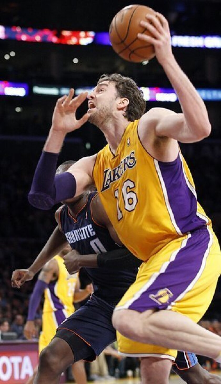 Pau Gasol drives to the basket against the Bobcats.