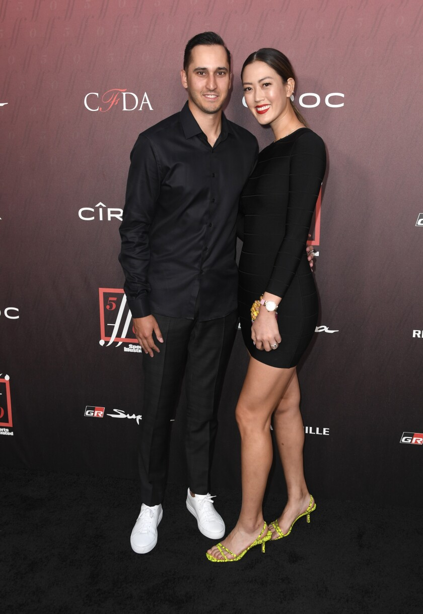 Jonnie West and Michelle Wie attend the Sports Illustrated Fashionable 50 on July 18, 2019, in Los Angeles.