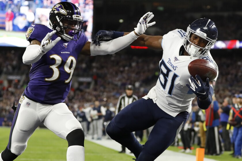 FILE - Tennessee Titans tight end Jonnu Smith (81) makes a touchdown catch against Baltimore Ravens cornerback Brandon Carr (39) during the first half an NFL divisional playoff football game in Baltimore, in this Saturday, Jan. 11, 2020, file photo. The Patriots have agreed to sign free agent tight end Jonnu Smith in their biggest move to date to fill the void created by the departure of Rob Gronkowski. Smith, who was selected by the Titans in the third round of the 2017 draft, agreed Monday, March 15, 2021, to a four-year, $50 million deal, his agent Drew Rosenhaus told The Associated Press. (AP Photo/Julio Cortez, FIle)