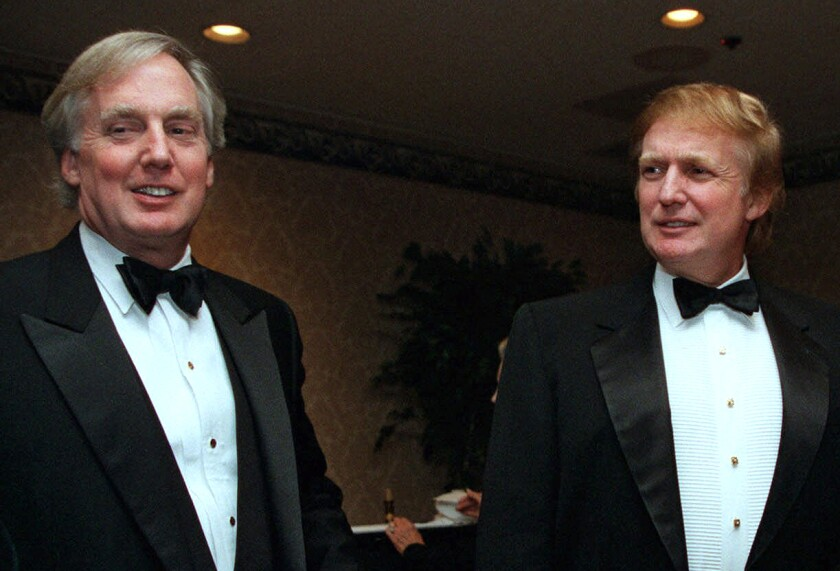Robert Trump, left, joins real estate developer and presidential hopeful Donald Trump at an event in New York.