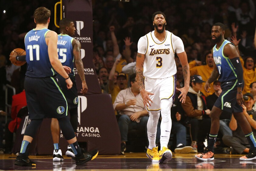 Lakers forward Anthony Davis reacts after a play against the Dallas Mavericks.