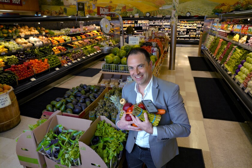 Standing in the produce aisle of Del Cerro's Windmill Farms grocery store is Bobby Brannigan, CEO and co-founder of Mercato. Windmill Farms is one of the tech startup's first local customers.