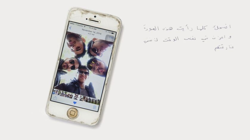 Photo of friends saved on a cell phone's screen evokes disparate memories for a refugee who laughs