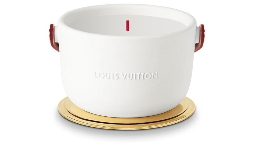 Louis Vuitton: Louis Vuitton?s L?air Du Jardin rose-scented fragrance candle is encased in white wi