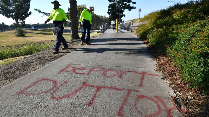 Anti-Peter Dutton graffiti appears on a bike path near his office in the suburb of Strathpine, north of Brisbane in Queensland, Australia, on Aug. 24, 2018.
